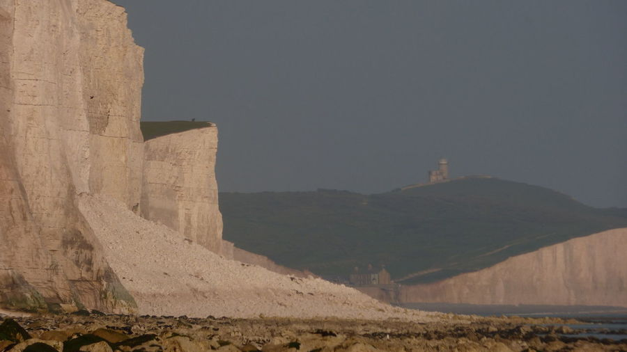 Collapsed Cliff at the Seven Sisters Chalk Cliffs Collapse Day Geology Landscape Lighthouse Nature No People Non-urban Scene Outdoors Rock Formation Scenics Seven Sisters Sky White Cliffs