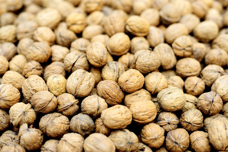 Walnuts background. EyeEmNewHere Abundance Background Background Photography Background Texture Backgrounds Brown Close-up Coffee Bean Day Food Food And Drink Foodphotography Freshness Full Frame Healthy Eating Indoors  Large Group Of Objects No People Nut - Food Nutshell Selective Focus Textured  Walnut Walnuts