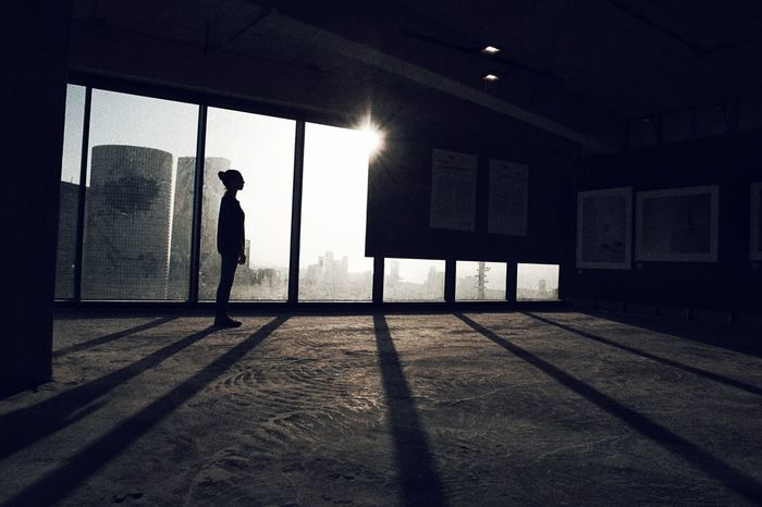 EyeEm Best Shots EyeEmNewHere EyeEm Of The Week Light And Shadow EyeEm Ready   One Person One Man Only People Adults Only Indoors  Adult Window Shadow Silhouette Architecture City The Graphic City Stories From The City