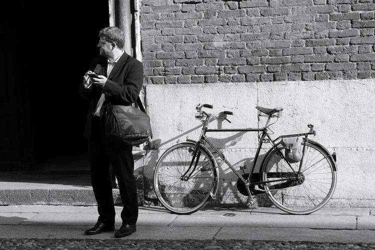 Bicycle leaning on sidewalk