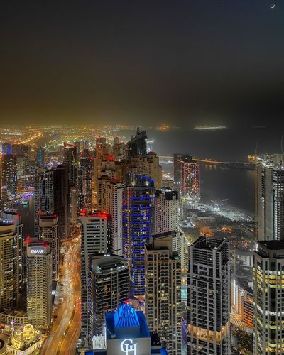 Dubai City Cityscape Urban Skyline Illuminated Modern Skyscraper Downtown District Business Finance And Industry Aerial View High Angle View Office Building Exterior Ferris Wheel Light Trail Financial District  Tail Light Office Building Big Wheel