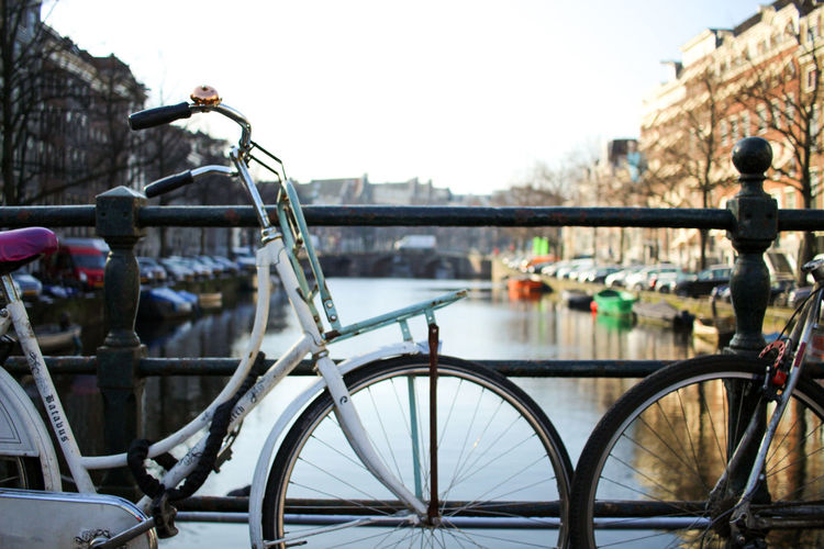 Bikes at a canal in Amsterdam Amsterdam Architecture City Clear Sky Netherlands Amsterdamcity Bicycle Bicycle Rack Bike Bikes Blue Sky Bridge Canal City Close-up Day Daylight Dutch Focus On Foreground No People Transportation Urban