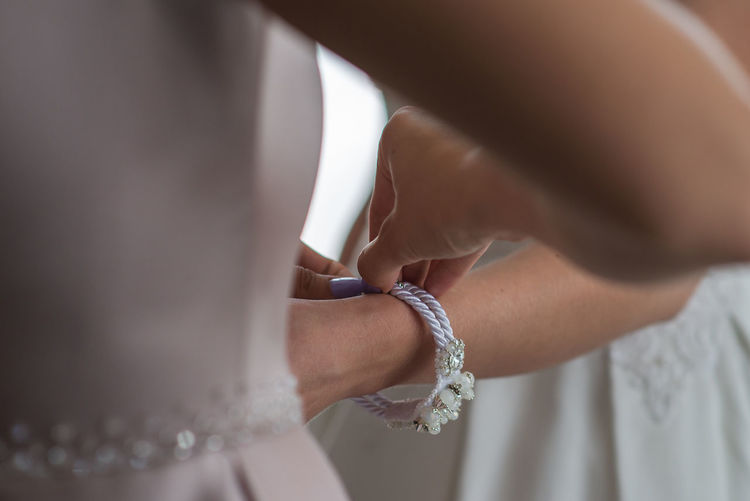 Women Human Body Part Midsection Hand Human Hand Jewelry Adult Two People Love People Bracelet Selective Focus Bride Wedding Close-up Indoors  Celebration Newlywed Togetherness Event Couple - Relationship Getting Dressed Pearl Jewelry Finger Wedding