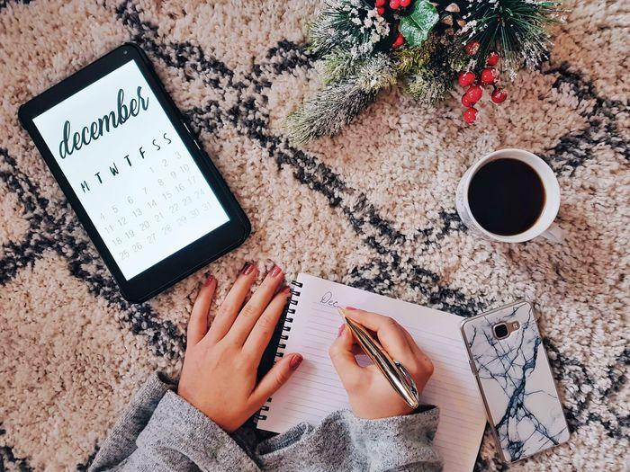 Calendar overhead shot, december, christmas, flat lay, coffee, at home.