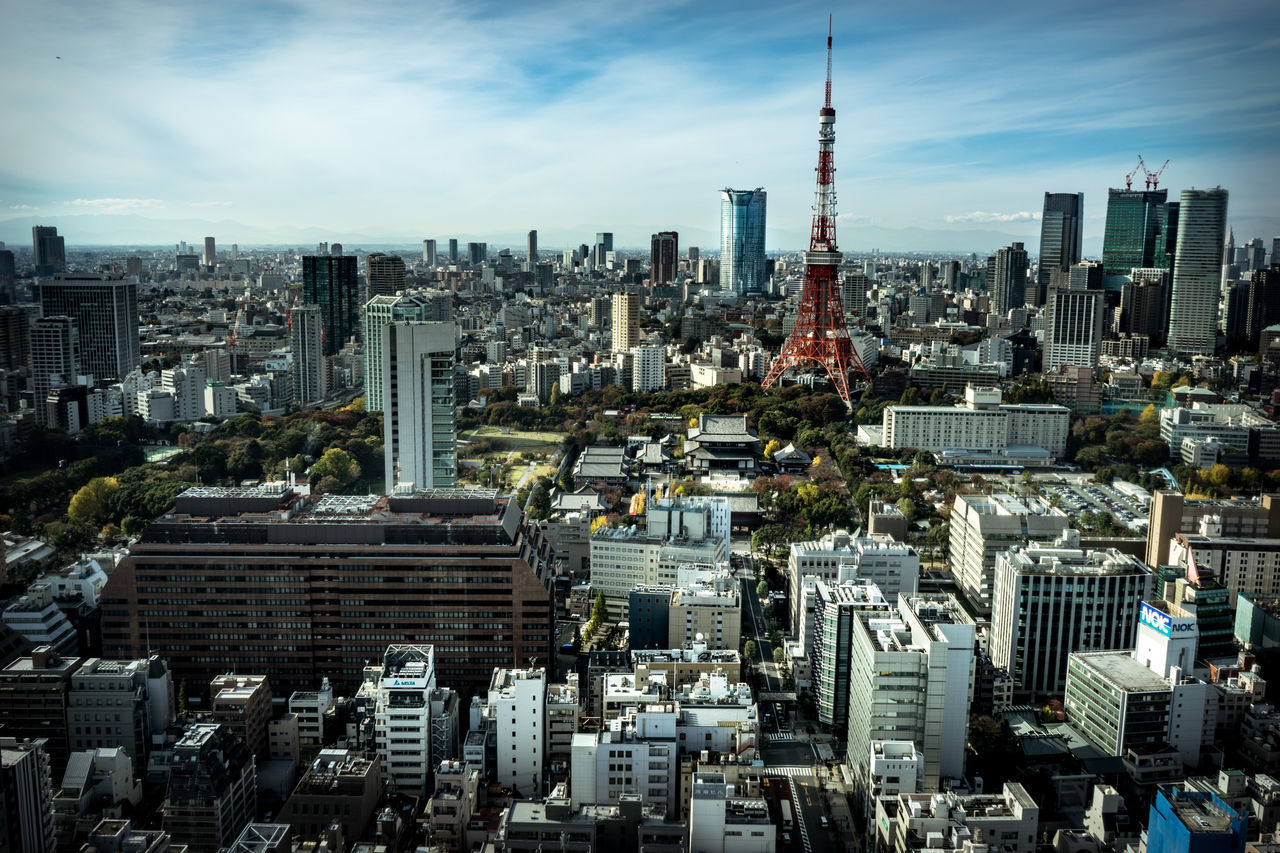 cityscape, skyscraper, architecture, tower, building exterior, tall - high, city, built structure, travel destinations, crowded, tall, urban skyline, sky, modern, outdoors, day