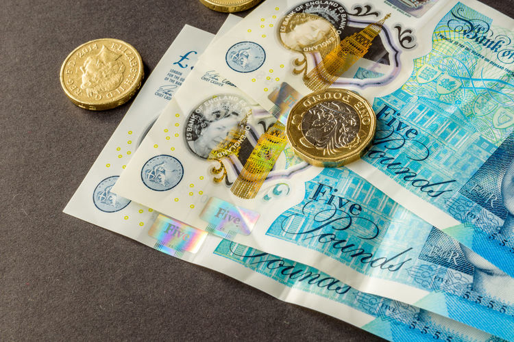 New five sterling pounds note and one pound coin Close-up Coin Currency Day England, UK Finance Five Pound Notes Indoors  Money New No People One Pound Coin Paper Currency Savings Uk Variation Wealth
