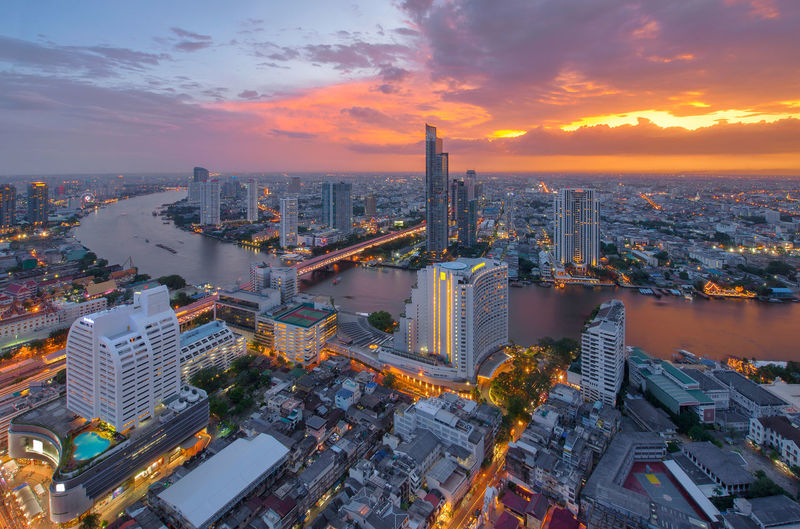 Chao Phraya River at sunset, Bangkok, Thailand Bangkok Cityscape Skyscrapers Thailand Architecture Building Exterior Buildings Built Structure Chao Praya River City Cityscape Cloud - Sky Day Downtown District High Angle View Illuminated Modern No People Outdoors Sky Skyscraper Sunset Taksin Bridge Urban Skyline