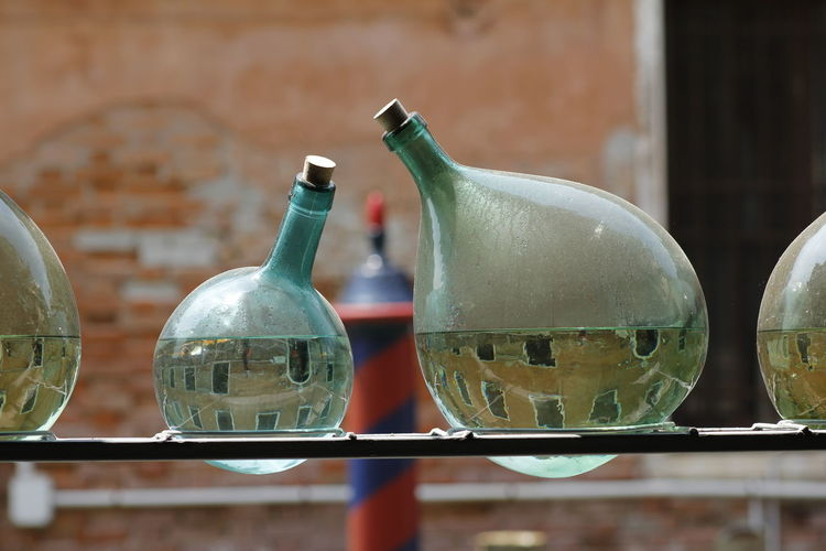 Close-up of glass bottles filled with water
