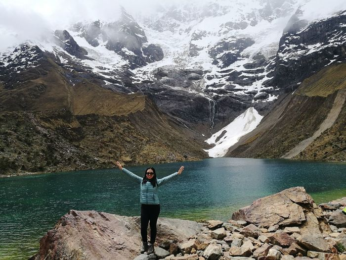 The feeling of freedom Woman Adventure Glacier Nature Beauty In Nature Cusco Peru Cuzco Nature Lover Water Mountain Standing Lake Rear View Full Length Sky Mountain Range Hiker Snowcapped Mountain Rocky Mountains Snow Covered Physical Geography