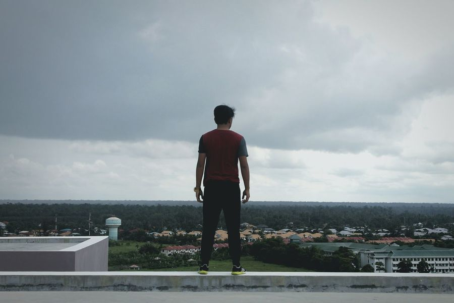 Whatever you do or did, is your choice, not others' Full Length Sky Roof Looking At View Standing People Agameoftones LeagueofLenses Portrait Portraiture Portrait Of A Man  Rear View Portraitsandchill PortraitPhotography StillLifePhotography EyeEmNewHere