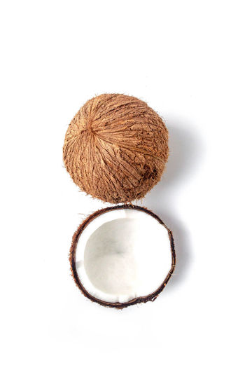 Brightly Lit Brown Close-up Coconut Copy Space Cut Out Directly Above Food Food And Drink Freshness Healthy Eating High Angle View Indoors  No People Shape Single Object Still Life Studio Shot Two Objects Wellbeing White Background