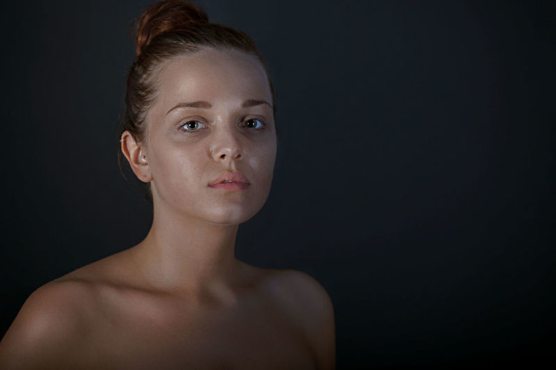 Adult Adults Only Beautiful People Beautiful Woman Beauty Black Background Close-up Formal Portrait Gray Background Headshot Human Body Part Human Skin One Person One Woman Only One Young Woman Only Only Women People Portrait Shirtless Skin Care Studio Shot Young Adult Young Women