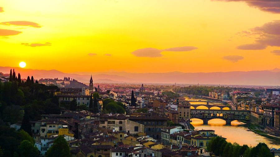 Sunset in Florence EyeEm Best Shots - Sunsets + Sunrise EyeEm Best Shots - Landscape Italy Florence Architecture Building Exterior Built Structure City Sky Sunset Cityscape Building Nature High Angle View Travel Destinations Orange Color Outdoors Tree