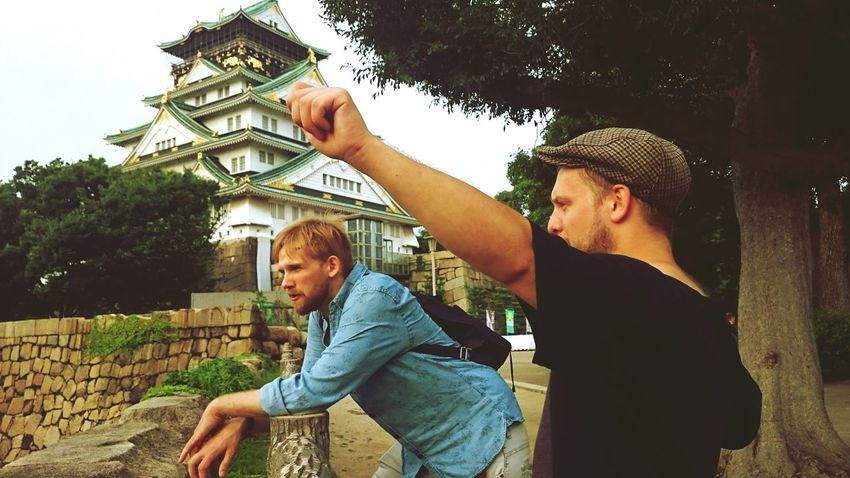 One is contemplating, one is using his imaginary bow. Contemplating Imaginary Osaka Castle