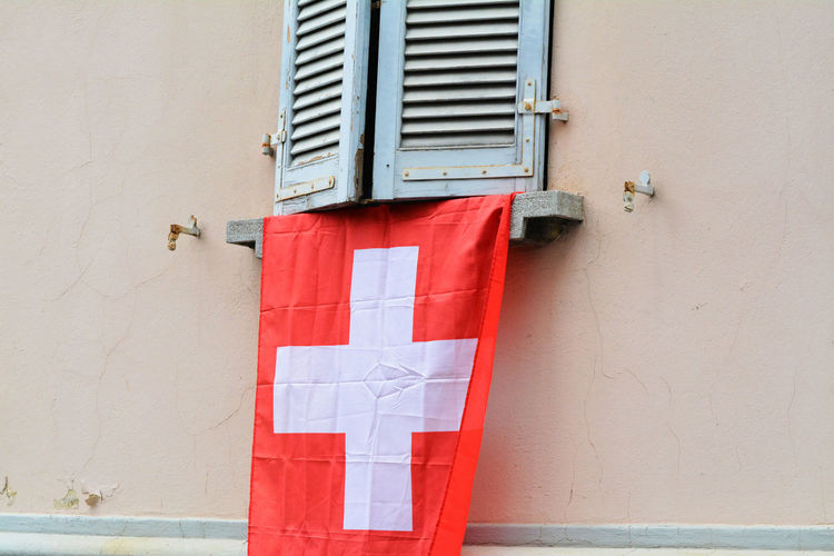 Swiss flag hanging from window