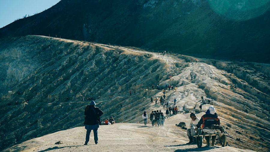Tourists hiking on mountain