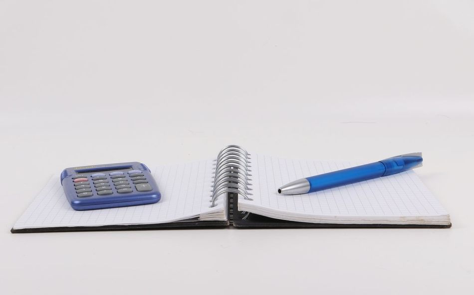 office equipment lying on the table Business Büro Desk Office Organizer Ringbuch Work Write Ballpen Calculator Close-up Copy Space Equipment Finance Indoors  Loose Leaf Note Pad NotePad Pen School Spiral Studio Shot Table Taschenrechner White Background
