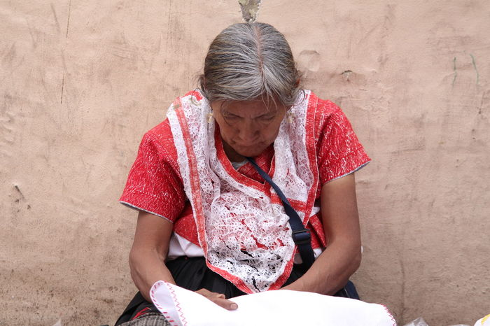 Mexican indigenous woman Looking Down Mexico Poor  High Angle View Indigenous Woman Lifestyles One Person Real People Sitting Women This Is Latin America Focus On The Story