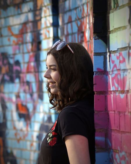 Friend Woman Wall Portrait Headshot City Individuality Fashion Mid Adult Graffiti Brown Hair Confidence  Close-up Street Art Brick Wall Hip Hop Dyed Hair Spray Paint Stories From The City