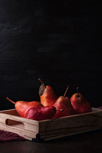 Dark Low Key Still Life Photography StillLifePhotography Black Background Close-up Copy Space Dark Photography Day Food Food And Drink Freshness Fruit Healthy Eating Indoors  No People Pear Still Life Studio Shot