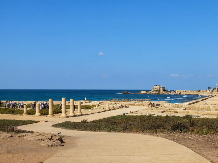 Caesarea's Antiquities Park Ancient, Antique, Archeology, Architecture, Art, Asia, Background, Beach, Beauty, Bible, Blue, Brick, Bright, Building, Caesarea, Calm, City, Clouds, Coast, Coastline, Construction, Culture, Harbor, History, Holy, Israel, Judea, Landmark, Landscape, Lines Beach Beauty In Nature Blue Caesarea, Israel, Keysarya, Palestine, Arab, Jew, Israeli, Palestinian Caesarea's Antiquities Park Coastline Day Empty Fishing Harbor Horizon Over Water Idyllic King Herod, Augustus Caesar, Caesar Nature No People Outdoors Remote Scenics Sea Shore Sky The Way Forward Tranquil Scene Tranquility Water