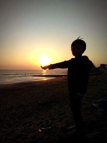 Fire in my hand Inas Sunset Sunset Snapchat ınstagram Followme Child Water Childhood Males  Sunset Sea Beach Boys Full Length Silhouette Sandy Beach Sand Shore Coast