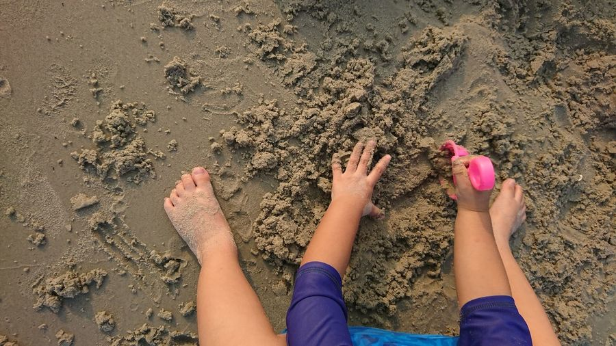 Low section of child on sand
