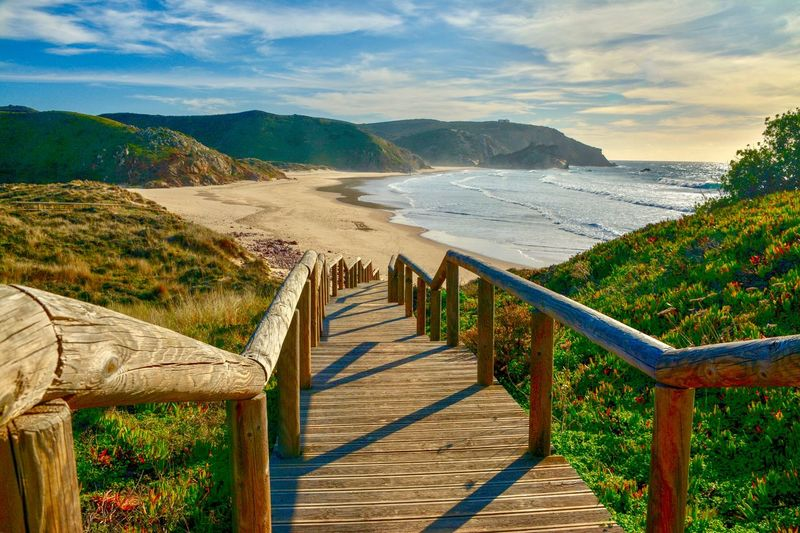 Costa Vicentina Surfers Paradise Water Sky Sea Mountain Beauty In Nature Nature Scenics - Nature Beach Tranquility Tranquil Scene Sunlight