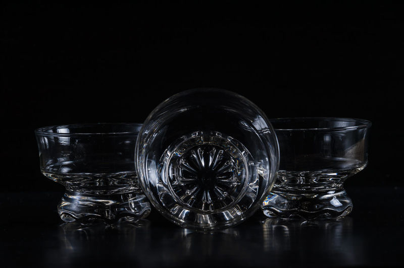 Close-Up Of Glass Bowls Against Black Background