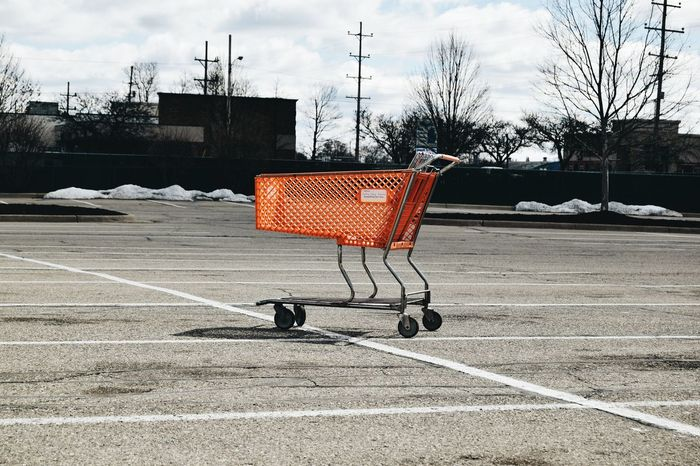 Taken in Jackson, MIShowcase April Urban Weird Modern VSCO Orange Orange Shopping Cart Shopping Cart Parking Lot Empty Parking Lot Vacant Lot Telling Stories Differently The Street Photographer - 2016 EyeEm Awards Live Love Shop Fine Art Photography Pivotal Ideas TakeoverContrast Finding New Frontiers Adapted To The City Uniqueness Lieblingsteil The City Light Art Is Everywhere Break The Mold BYOPaper! Visual Creativity The Still Life Photographer - 2018 EyeEm Awards