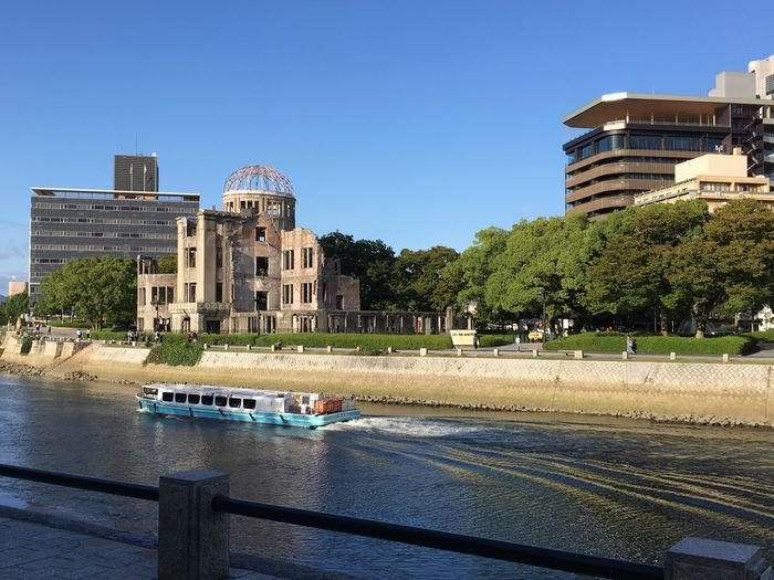 High angle view of barge sailing on river by hiroshima peace memorial