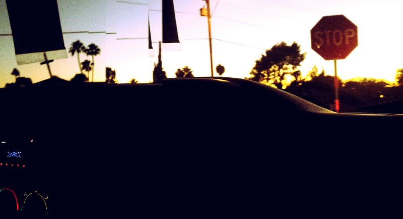 dynamicTaking Photos Drive By Shooting Stop Sign Darkening Last Goodbye Last Glimpse Car Driving Passenger From Car Window Sunset Gloomy Glitch Panorama Cross