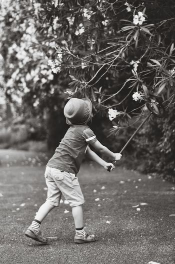Childhood One Person One Boy Only Fun Tree Headwear Outdoors Nature Leisure Activity Summer Memories 🌄 Black&white Tree Flower
