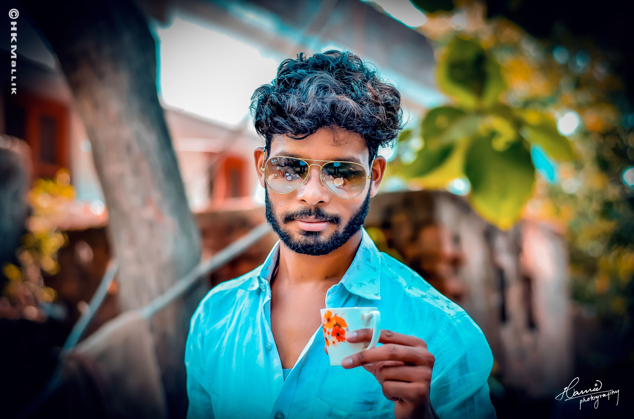food and drink, real people, front view, one person, lifestyles, leisure activity, holding, incidental people, portrait, young men, young adult, beard, focus on foreground, casual clothing, facial hair, glasses, food, men, mid adult men, smiling, fashion