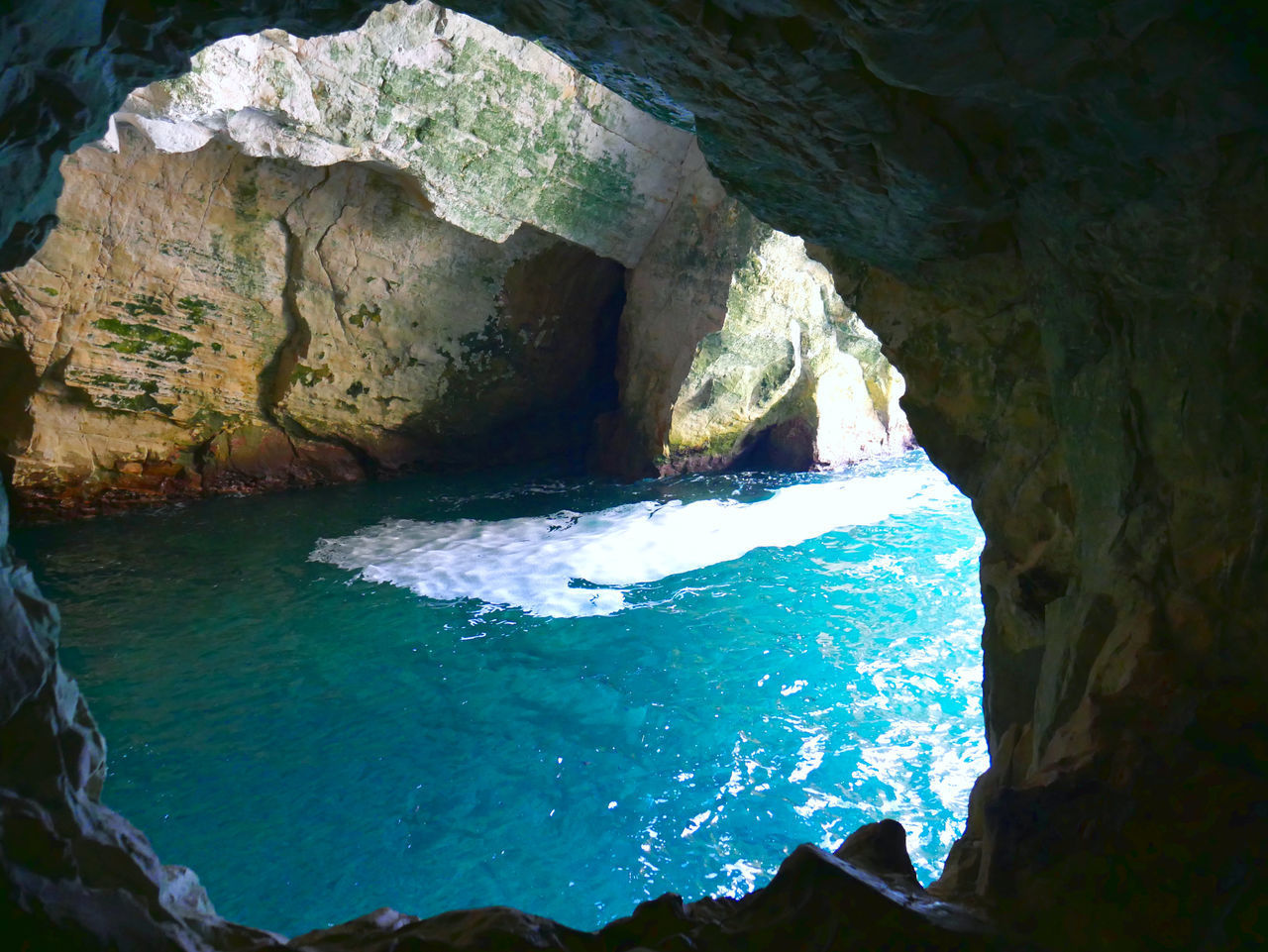 water, rock, rock - object, solid, nature, rock formation, sea, no people, beauty in nature, day, cave, outdoors, scenics - nature, waterfront, geology, physical geography, tranquility, tranquil scene, motion, turquoise colored, eroded, flowing water