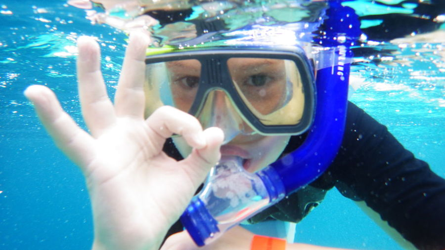 Close-up of child snorkeling underwater