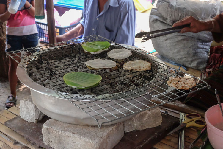 grill flour traditional candy style Rice Flour Sweet Food Stove Eating Flour Coconut Grill Candy Dessert Men Working Market Chef Close-up Food And Drink For Sale Street Market Shop Market Vendor Street Food Prepared Food Farmer Market Market Stall Retail Display