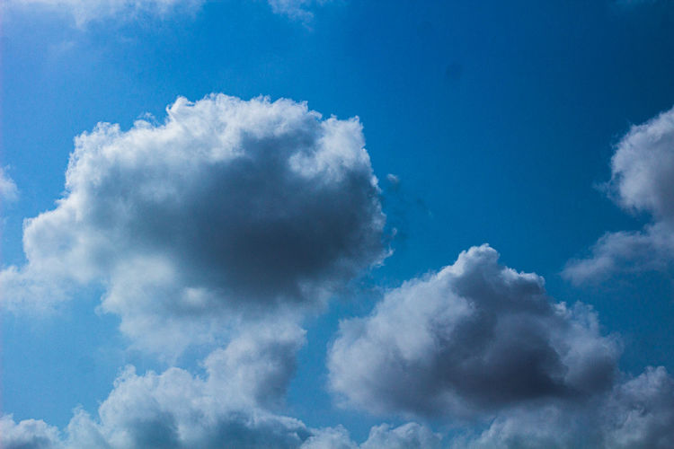 Low angle view of cloudscape against blue sky