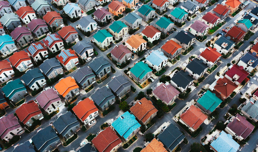 High angle view of multi colored houses in city