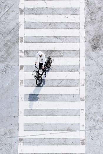 Shadow of man on bicycle