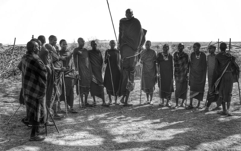 Full Length Standing Clear Sky In A Row Crowd Massai Jumping Outdoors Black And White Black & White Blackandwhite Blackandwhitephotography People And Places People Of EyeEm Travel Travel Photography Travelphotography Serengeti Olduvai Safari