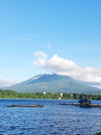 """Sampaloc Lake with a 3.7 km circumference is the largest and the most popular lake of San Pablo City which is also known as """"City of Seven Lakes"""". Sampaloc Lake Lake Lakeview Tree Scenics Travel Destinations Nature Water Sky"""