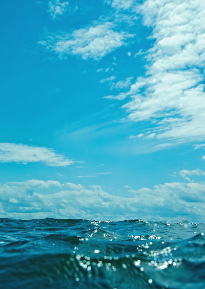 Surface level of sea against blue sky