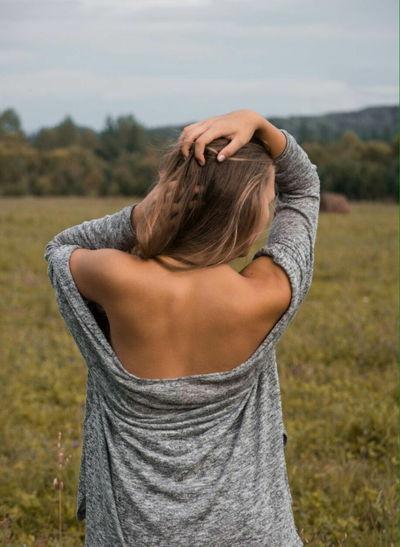 Woman looking away on field