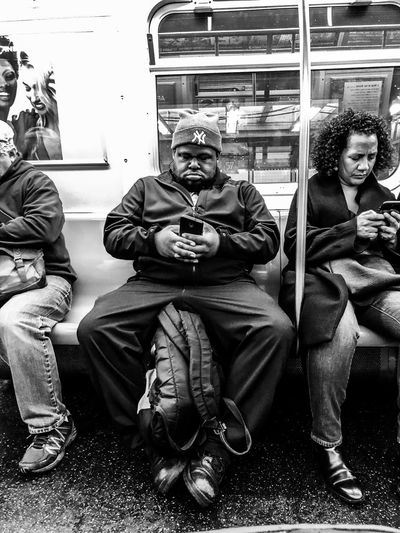 Subway Life EyeEmNewHere EyeEm Best Shots Cellphone Mobile Phone Real People Mode Of Transportation Transportation Lifestyles Sitting People Men Land Vehicle Public Transportation Adult Group Of People Travel Subway Train