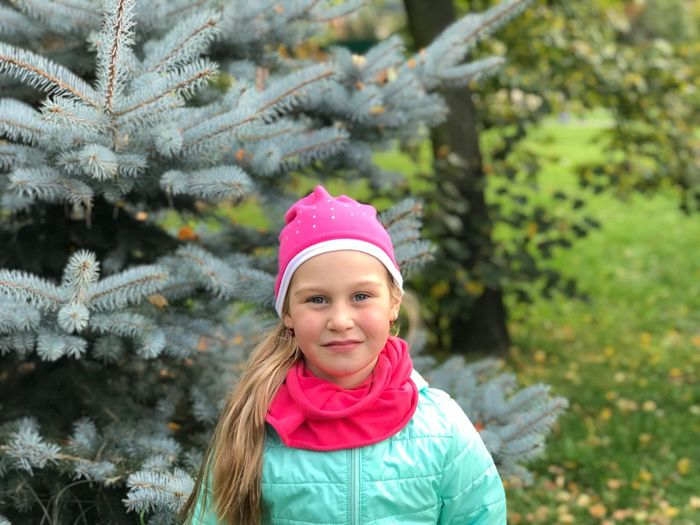 Childhood Girls Christmas Pink Color One Girl Only Child Winter Christmas Tree Tree Headshot Smiling Portrait Blond Hair Children Only One Person Day Outdoors Close-up Warm Clothing IPhone Photography IPhone Photos IPhone 7 Plus EyeEmNewHere EyeEmNewHere Fashion Stories Press For Progress