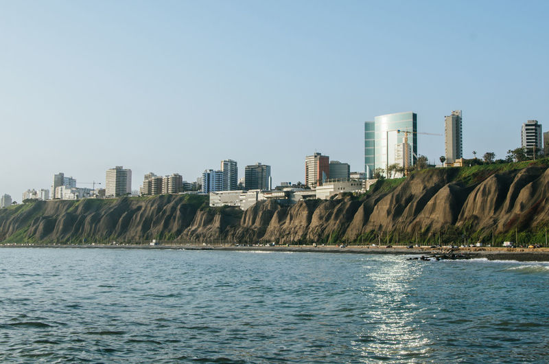 View of Lima from the fishermen's beach in Chorrillos Lima Peru People Beach Sea City Town Coast Sky Travel Destinations Landscape Architecture Tourism Ocean Landmark Panoramic Cliff Miraflores Building Exterior Cityscape Pacific Ocean