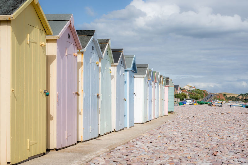 Architecture Beach Beach Hut Building Building Exterior Built Structure Cloud - Sky Day Door Entrance House Hut In A Row Land Multi Colored Nature No People Outdoors Pastel Colors Side By Side Sky