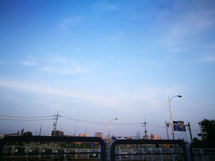 A Street Lamp Telephone Pole Moon Flying City Sky