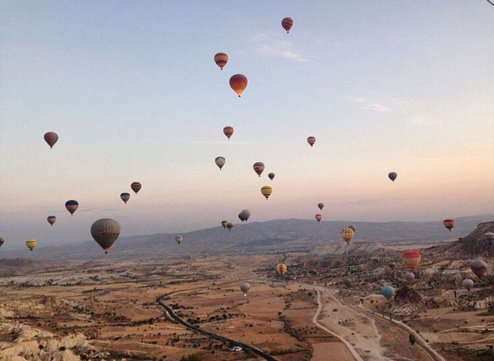 Mid-air Hot Air Balloon Sky Flying Outdoors Beach Sand Sunset Nature No People Ballooning Festival Day